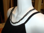 multi-strand necklace of tint glass beads on fine cotton